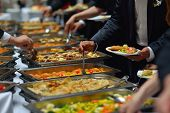 foto of buffet lunch  - people group catering buffet food indoor in luxury restaurant with meat colorful fruits  and vegetables - JPG