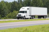 picture of semi-truck  - big white truck driving on a road