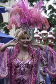 Female impersonator riding in Provincetown Carnival Parade