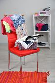 foto of sluts  - Heap of  clothes on color chair - JPG