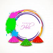 Indian festival Happy Holi celebrations with bright colors gulal (dry colors) and space for your wishes.