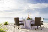 romantic table setup on tropical beach