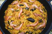 Paella with prawns and mussels typical Spanish dish ingredients of the Mediterranean