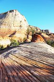 Striped cliffs of red sandstone.Zion National Park, sunset