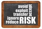 risk management strategies - ignore, accept, avoid, reduce, transfer and exploit - word cloud on a v