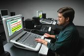 Man Working At A Digital Sound Mixing Board