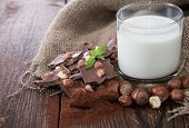 picture of hazelnut  - Hazelnut Chocolate and Milk on wooden background