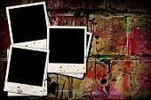 Photo Frames On Old Brick Wall
