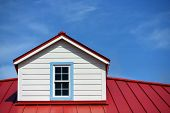 stock photo of red roof tile  - Close up a red roof detail house and a blue sky - JPG