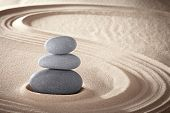 stock photo of purity  - spa treatment concept japanese zen garden stones tao buddhism conceptual for balance harmony relaxation meditation wellness background harmony and purity stone stack in sand pattern spiritual elements - JPG