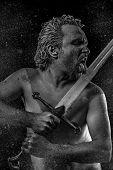 pic of longsword  - Wild Warrior with huge metal sword - JPG
