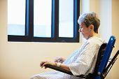 Senior Female Patient Sitting Alone In Wheelchair