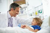image of intensive care unit  - Young Girl Talking To Male Doctor In Intensive Care Unit - JPG