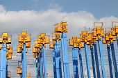 pic of cherry-picker  - Cherry picker platform against a sky with clouds - JPG