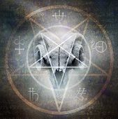 stock photo of baphomet  - Black mass montage of occult goat skull overlaid with a Satanic pentagram materialising against a grunge texture background of alchemy symbols - JPG