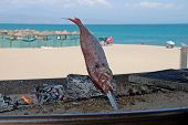 Fish on barbecue on beach, Benalmadena, Spain.