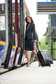 Young Business Woman Embarking On Train