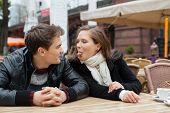 Woman Teasing Man While Sitting Restaurant