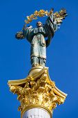 Independence Monument In Kiev, Ukraine. This Is A Statue Of An Angel, Made Of Copper, And Gold Plate