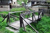 image of wallow  - Wooden bridge in medieval Bozhentsi village in Bulgaria - JPG
