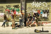 ATHENS, GREECE - MAY 10, 2014: Unidentified street musicians play for tourists. Tourism is a decisiv