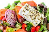 closeup of greek salad with large piece of feta