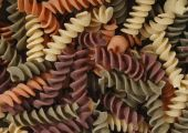 uncooked fusilli pasta background