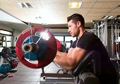 stock photo of preacher  - biceps preacher bench arm curl workout man at fitness gym - JPG