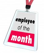Employee of the Month words on a name tag or badge recognize top performing worker