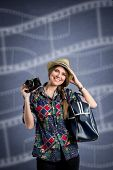 Young happy photographer over design background