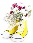 Beautiful gumshoes with flowers inside, isolated on white