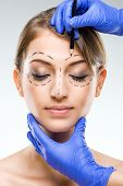 Plastic surgery - Beautiful woman face with surgical markings