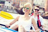 A picture of a young couple in a canoe sightseeing Gdansk in Poland