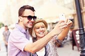 A picture of a happy couple taking a picture of themselves while sightseeing