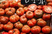 Many Beefsteak Tomatoes On A Market Stall