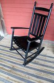 Black rocking chair on porch