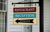 picture of reception-area  - Colorful sign on black metal post - JPG