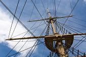 picture of big-rig  - Mast and rigging of a big old sailing ship in front of a blue sky - JPG
