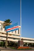 A military guard raises the flag of Cape Verde, near the National Assembly on December 20, 2009