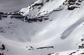 stock photo of avalanche  - Mountains with snow cornice and traces from avalanches - JPG
