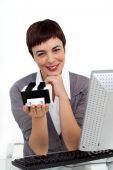 Glowing Businesswoman Holding A Business Card Holder