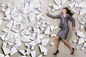 Funny image of businesswoman running with documents in hand