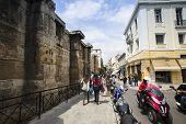 ATHENS, GREECE - MAY 10, 2014: Athenians and tourists in center of city. Tourism is a decisive secto