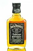 Small bottle of Jack Daniels whiskey isolated on white background