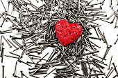 Love Heart On Pile Of Iron Nails