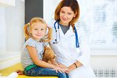 Portrait Of Pediatrician And Little Girl Patient.