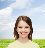 happiness and people concept - smiling little girl over white background