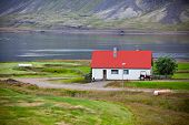 Typical Farm House At Icelandic Fjord Coast