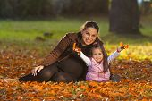 Young Girl With Her Mother In Autumn Color