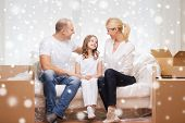 family, people, accommodation and happiness concept - smiling parents and little girl moving into new home over snowflakes background